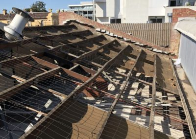 removing asbestos from a chemist roof in Lygon street